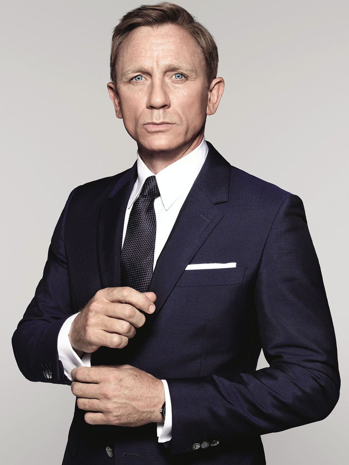 business professional dress code men James Bond suit style - Luxe Digital