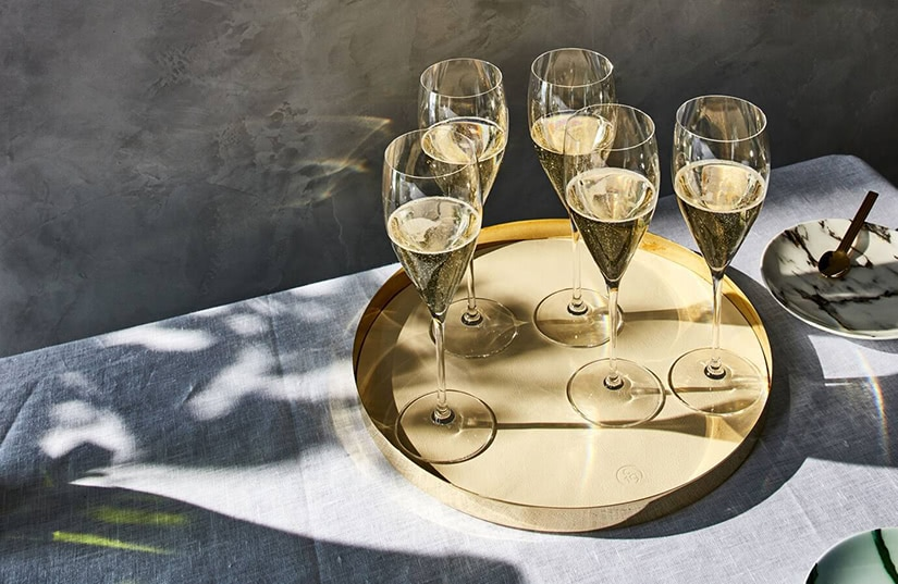 serving glasses best champagne brands luxe digital