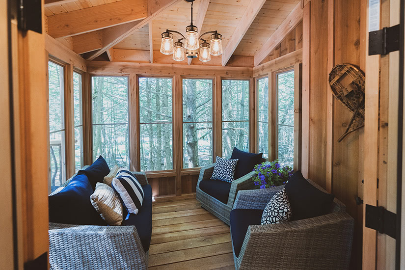the woods maine treehouse porch luxury - Luxe Digital