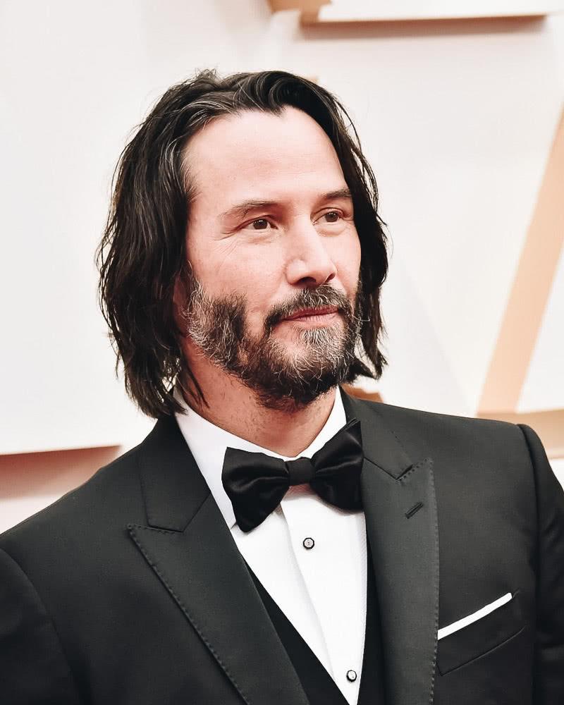 best long hairstyles men messy keanu reeves - Luxe Digital